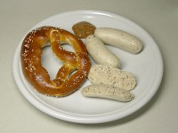 Weisswurst with pretzel and mustard en.wikipedia.org